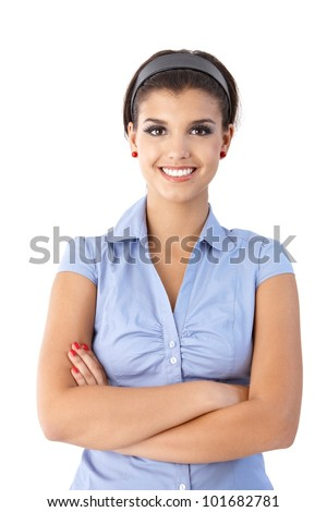 Portrait of confident smiling young woman, looking at camera.