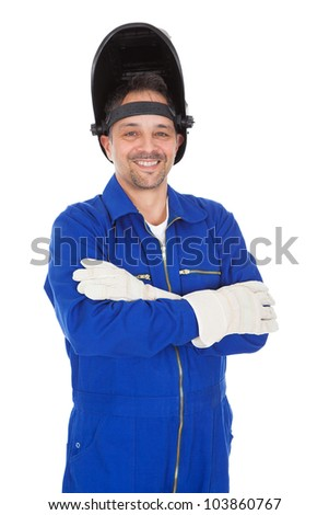 Portrait of confident welder in the mask. Isolated on white