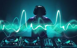 Portrait of confident young DJ with headphones