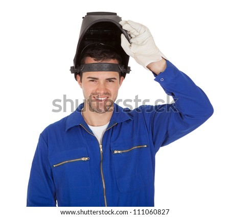 Portrait of confident young welder. Isolated on white