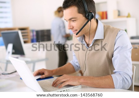 Portrait Of Consultant On The Phone With Headset