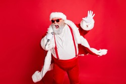 Portrait of cool funny fat overweight santa claus with big belly sing song on christmas party wear style stylish trendy eyeglasses eyewear hat isolated over red background