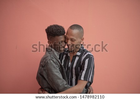 Portrait of couple being affectionate against colorful backgroun