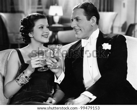 Portrait of couple having drinks