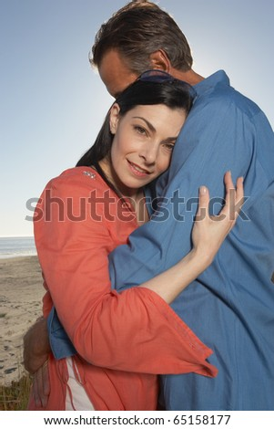 Portrait of couple hugging at beach