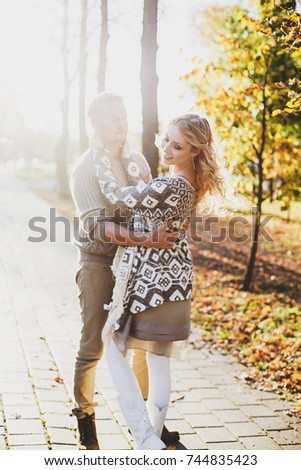 portrait of couple in autumn on nature, love #744835423
