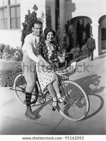 Portrait of couple on bicycle together