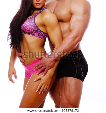 Portrait of couple posing in gym