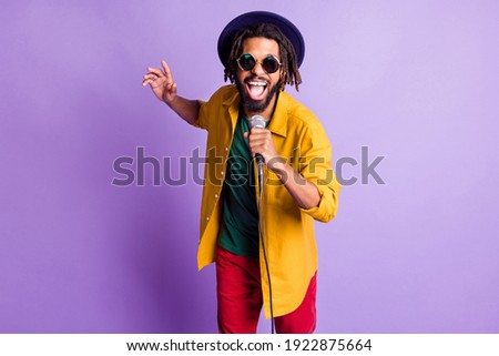 Portrait of crazy funny dark skin person open mouth sing have fun good mood isolated on purple color background ストックフォト ©