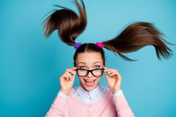 Portrait of crazy funny funky high school girl student touch spectacles impressed incredible lesson lecture schedule wear pastel clothes hair fly isolated blue color background