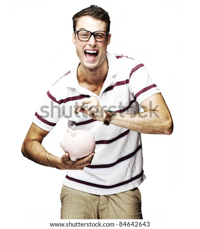 portrait of crazy man saving money in piggy bank against a white background