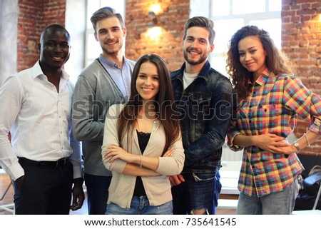 Portrait of creative business team standing together and laughing. Multiracial business people together at startup #735641545
