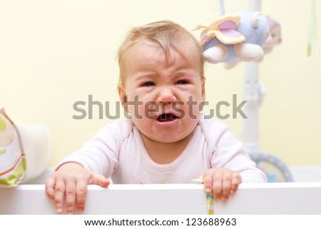 Portrait of crying baby girl.