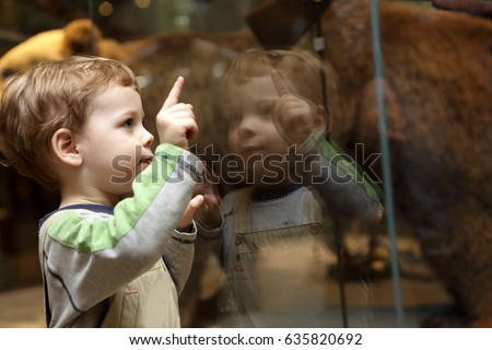 Portrait of curiosity child in a museum