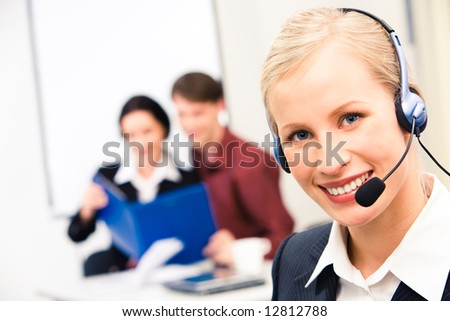 Portrait of customer service representative wearing headset and looking at camera