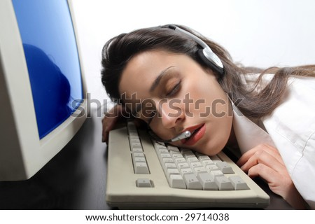portrait of customer support operator woman falling asleep - stock photo