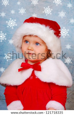 portrait of cute baby girl in red santa hat and dress