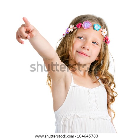 Portrait of cute blond girl pointing with finger. Isolated on white.