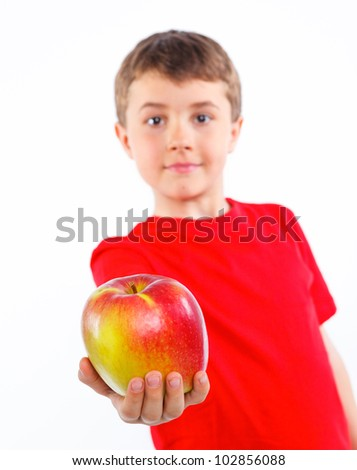 Portrait of cute boy with apple. Fokus on the apple. Isolated on white background.