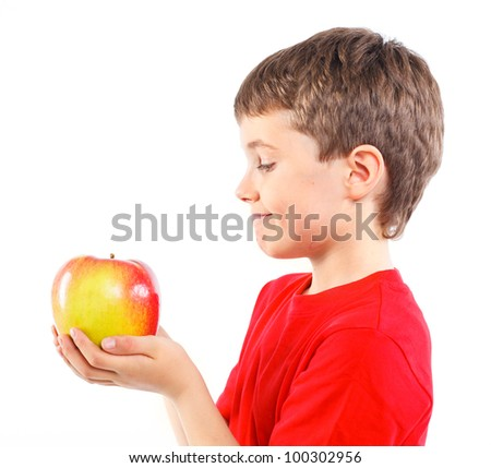 Portrait of cute boy with apple. Isolated on white background.