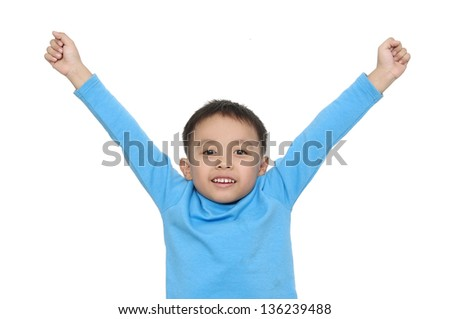 portrait of cute boy with blue shirt gesturing with his arms