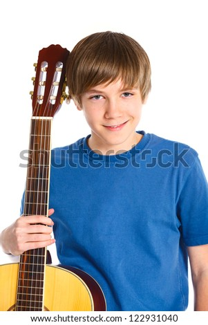 Portrait of cute boy with classical guitar. Isolated on white background
