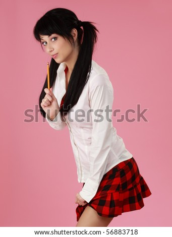 portrait of cute caucasian black haired woman, pink background