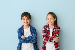 Portrait of cute children on color background