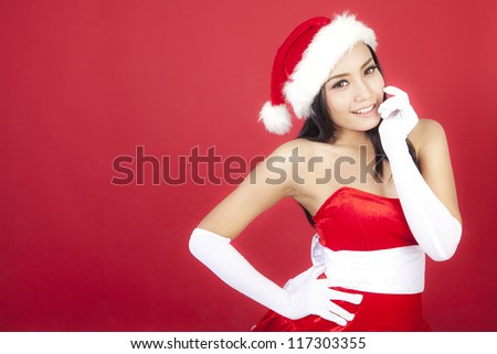 Portrait of cute christmas woman wearing christmas costume. shot over red background