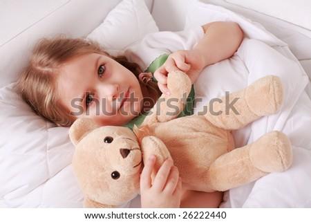 Portrait of cute cute little girl with teddy