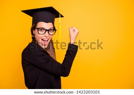 Portrait of cute delighted funny funky teen teenager raise fists winner yes yeah scream shout eyewear eyeglasses black jacket fashionable tails isolated pigtail yellow background