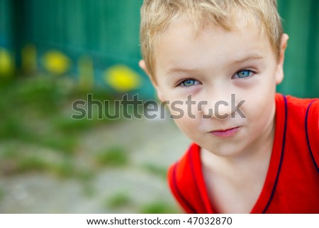 Portrait of cute expressive funny blond kid