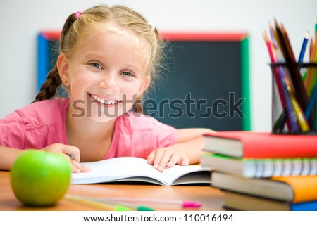 Portrait of cute girl at workplace with the apple