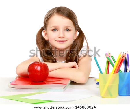 Portrait of cute girl at workplace with the books