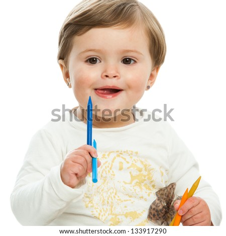Portrait of cute girl holding color wax crayons.isolated.