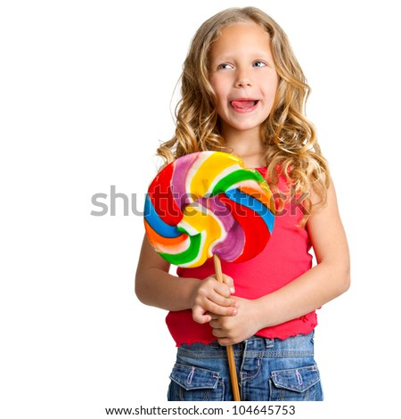 Portrait of cute girl holding huge colorful candy.Isolated on white.