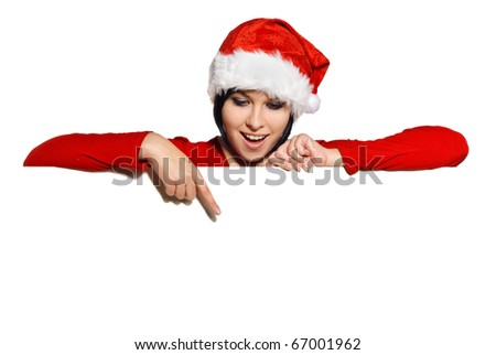 Portrait of cute girl in a Santa cap with Blank sign. Isolated on white