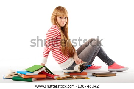 Portrait of cute girl with textbook in hands looking Isolated on white background