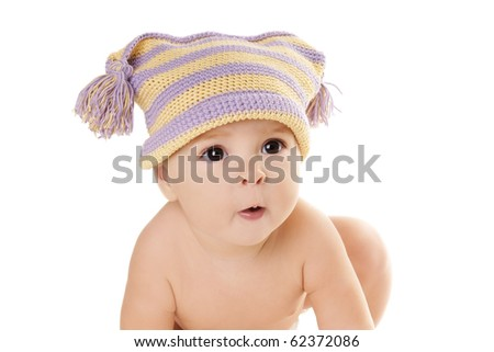 Portrait of cute grimacing baby girl in funny hat isolated on white background - stock photo
