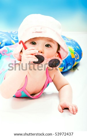 Portrait of cute little baby girl with sunglasses