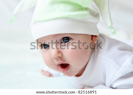portrait of cute little baby in a funny hat