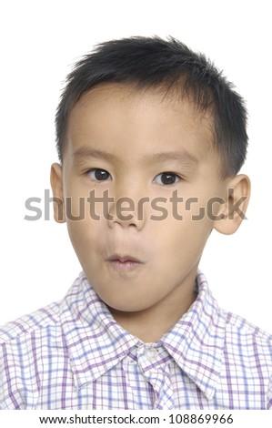 portrait of cute little boy in studio