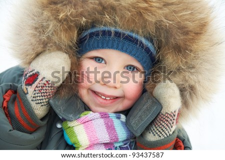 Portrait of cute little boy in winter time