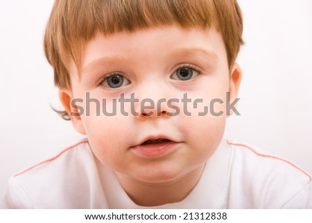 Portrait of cute little boy looking to the camera