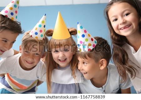 Portrait of cute little children in Birthday hats indoors #1167758839