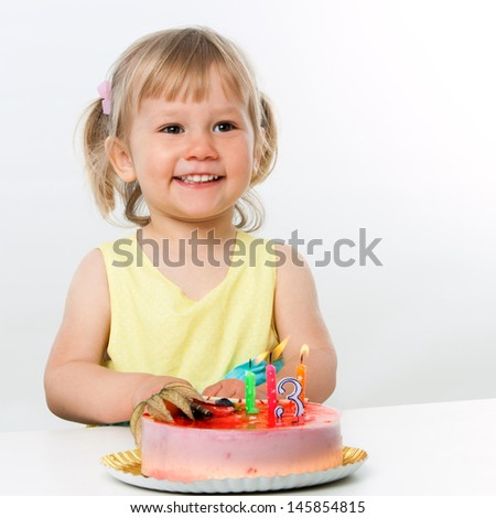 Portrait of cute little girl celebrating third birthday.Isolated.