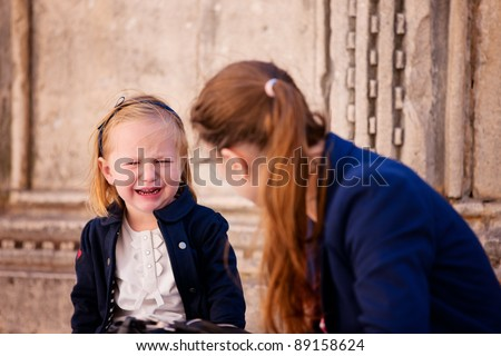 Portrait of cute little girl crying