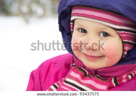 Portrait of cute little girl in winter time