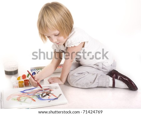 portrait of cute little girl painting