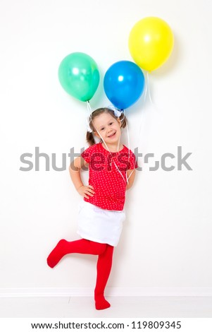 Portrait of cute little girl with bunch of balloons